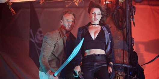 SHARKNADO: THE 4TH AWAKENS -- Pictured: (l-r) Ian Ziering as Fin Shepard, Masiela Lusha as Gemini -- (Photo by: Tyler Golden/Syfy)